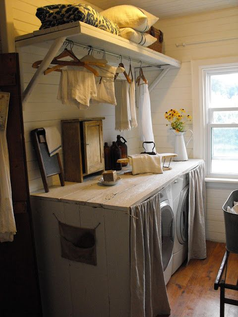 Rustic Farmhouse - I really love the idea of having a folding table on top of the washer/dryer and what a great way to hide them too!