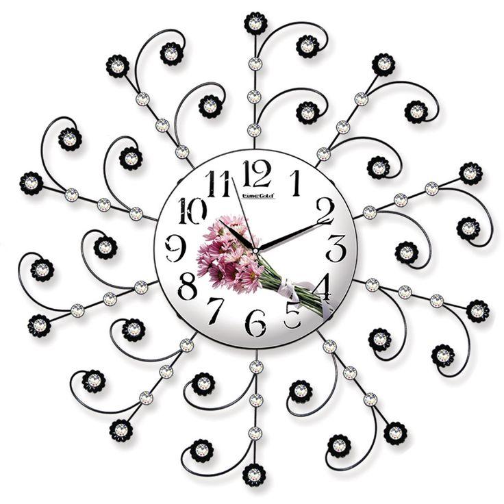 Taşlı Ferforje Dekoratif İlginç Duvar Saati  Ürün Bilgisi ;  Ürün maddesi : Metal gövde, gerçek cam Ebat : 75 cm  Mekanizması : Akar saniye, sessiz çalışır Garanti : Saat motoru 5 yıl garantili Taşlı Ferforje Dekoratif İlginç Duvar Saati Üretim  : Yerli üretim Kullanım ömrü uzundur Kalem pil ile çalışmakta Ürün fotoğrafta görüldüğü gibi olup orjinal paketindedir Sevdiklerinize hediye olarak gönderebilirsiniz