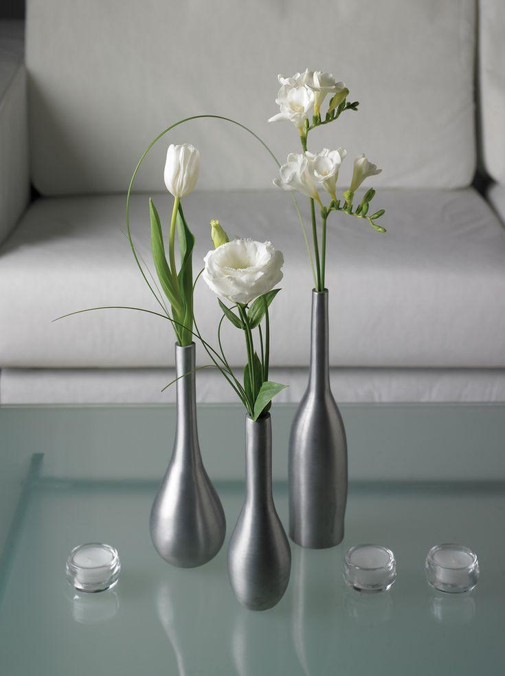 16 best home decor flowers images on pinterest flower arrangements simply sophisticated trio single flower in a silver bud vase gives a dramatic look to teraionfo