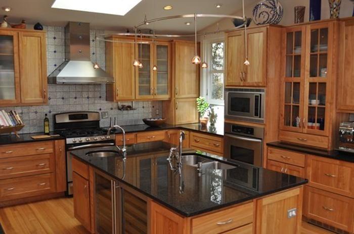 wood cupboards, black kitchen countertops - silver kitchen items )no white!