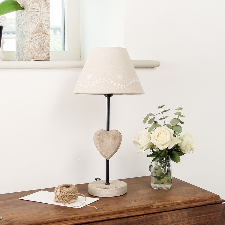 This beautiful lamp is made from wood with a metal stem and heart detailing to the french country lightinghallway