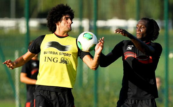 Belgium's Marouane Fellaini (L) and Romelu Lukaku attend on September 4, 2013 a training session of the Belgian national football team, the Red Devils, in Brussels ahead of a 2014 FIFA World Cup qualification match against Scotland  on September 6 in Glasgow