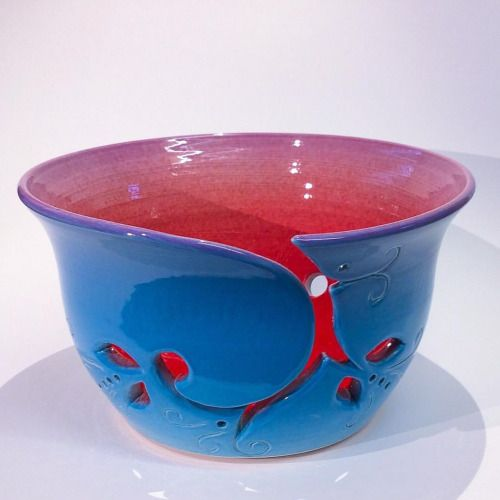 Yarn bowl in red purple and blue glaze.