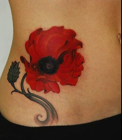 Red poppy belly tattoo