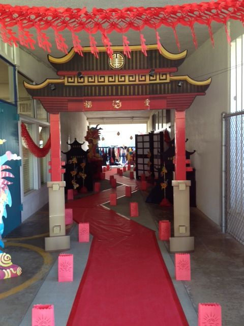 Chinese entryway at our elementary school.Used school paper and duct table for path. Luminaries, hanging lanterns, etc. Shanghai Nights theme