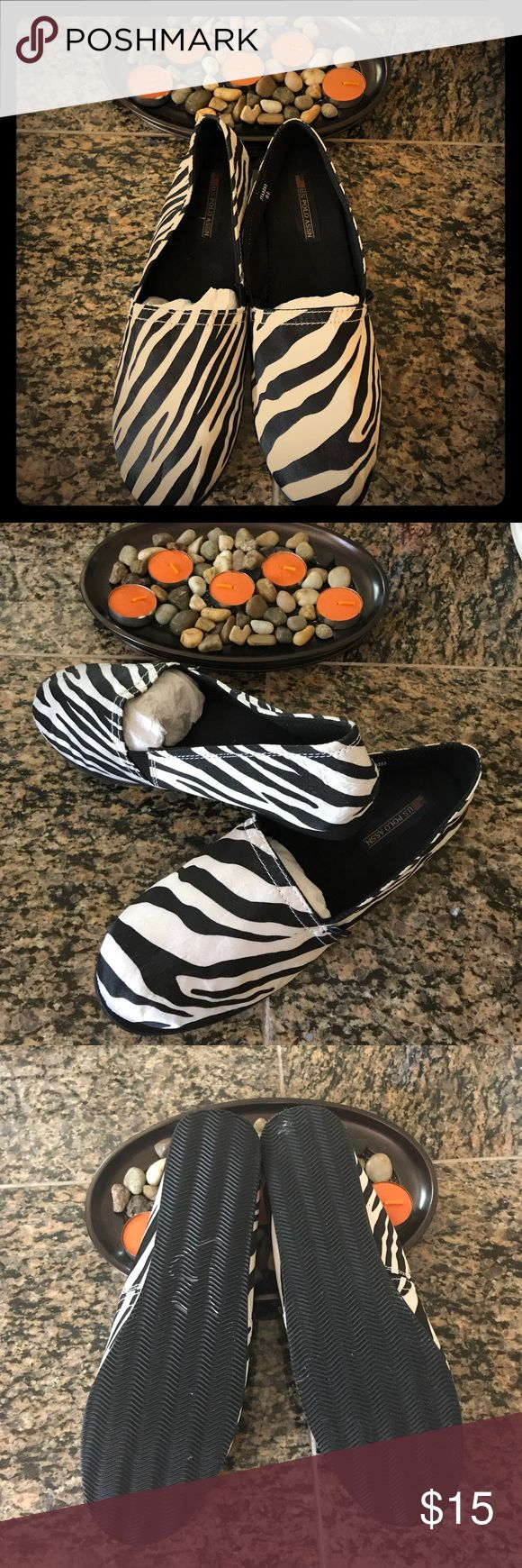 Comfortable & stylish shoes. Just found this fun and comfortable zebra shoes while cleaning one of my closets. They're brand new no tags but never been worn before. U.S. Polo Assn. Shoes Flats & Loafers