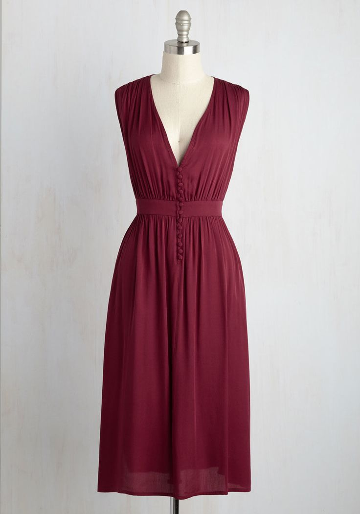 <p>Just days before your flight took off, you discovered this merlot midi dress. Now, you're standing port-side, elegantly in the plunging neckline, gathered waist, and delicate buttons of this breezy dress, beautifully breathing in the light sea air.</p>