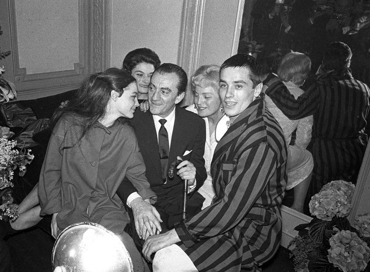With Romy and Luchino Visconti, among others.