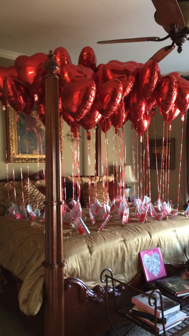 50 balloons representing 50 Valentines Days together - first date on Valentine's Day 1965. Each is tied with anchors consisting of red/gold marbles with a message printed on red paper folded and placed inside each bag.  Paper punch made in upper corner for ribbon to be tied.