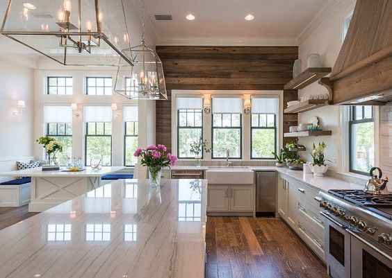We love this galley kitchen design with built in breakfast nook