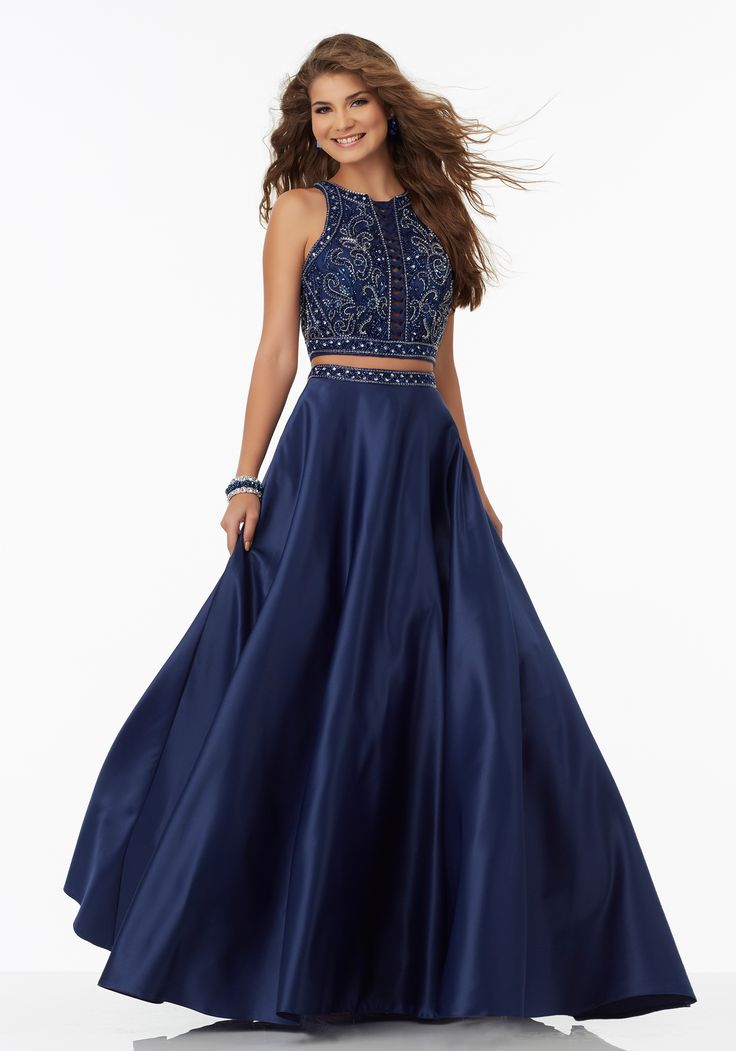 Prom Dresses by Morilee designed by Madeline Gardner. Two-Piece Satin Prom Dress with Intricately Beaded Bodice and Lattice Detail.