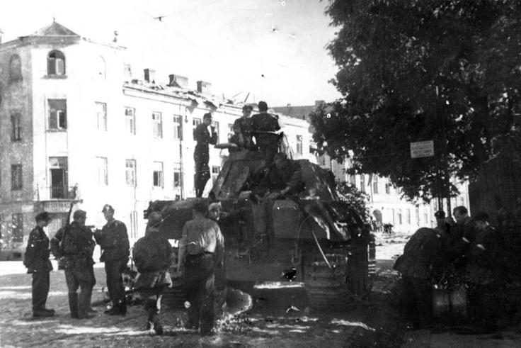 "2 August 1944, soldiers of tank platoon ""Wacek"", Company ""Giewont"", Battalion ""Zośka"" on a German Panther tank on the corner of ul. Okopowa and ul. Żytnia."