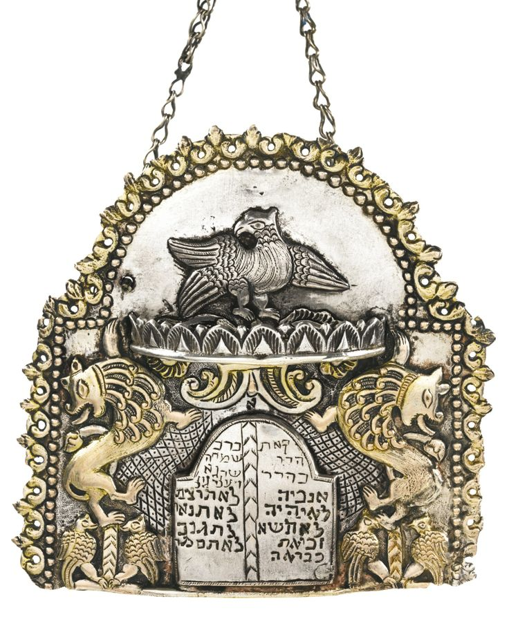POLISH SILVER SMALL TORAH SHIELD the arched backplate embossed with a spread-winged eagle, two rampant lions, and two pairs of birds flanki...