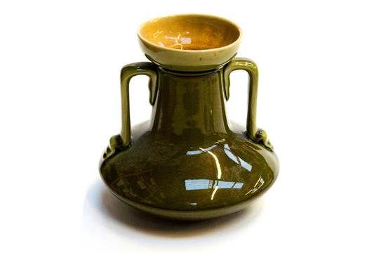 Christopher Dresser for Linthorpe, an Aesthetic Movement art pottery vase, twin handled, bulbous
