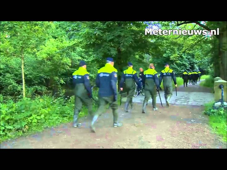 Lots of Dutch Policemen in Rubber Chest Waders