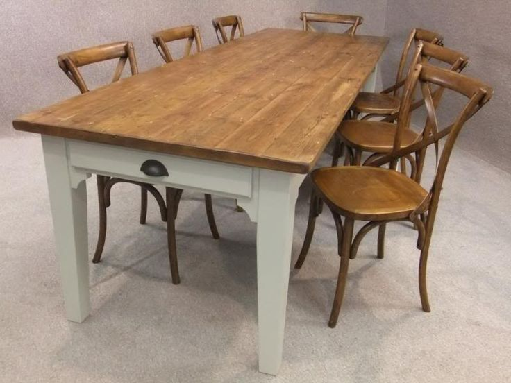 Reclaimed pine country farmhouse kitchen table with a painted bas