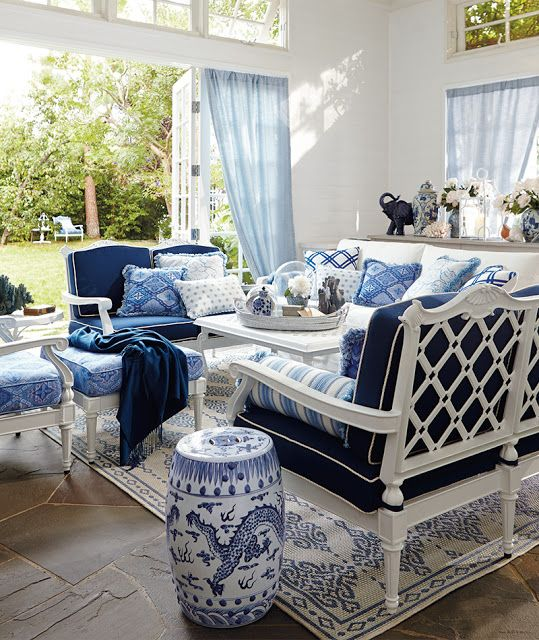 Blue And White Open Air Living Stone Floor French Doors Wrought Iron In A Light Ceiling Ralph Lauren Fabric