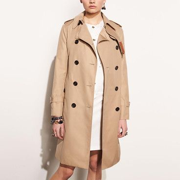 icon trench by COACH. The Coach trench gets a feminine touch this season thanks to a trimmer, more refined fit. Its leather belt and gromme...