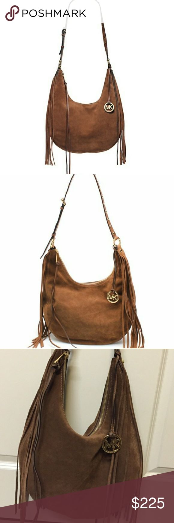 "Michael kors caramel Rhea hobo Beautiful suede slouchy hobo in excellent used condition. This is an original Rhea bag that was first introduced a few years ago.  The ones they sell in stores now have a different lining inside.  Material: Suede  Color: Dark Caramel  Gold~Tone Hardware  Adjustable Shoulder Strap w/ 23""Drop  Top Zip Closure  Long Fringe On Both Sides  MK Hanging Logo Charm is scratch free  Approx. Measurements: L 15""x H 11""x D 3""  This bag is in excellent condition.  Looks…"