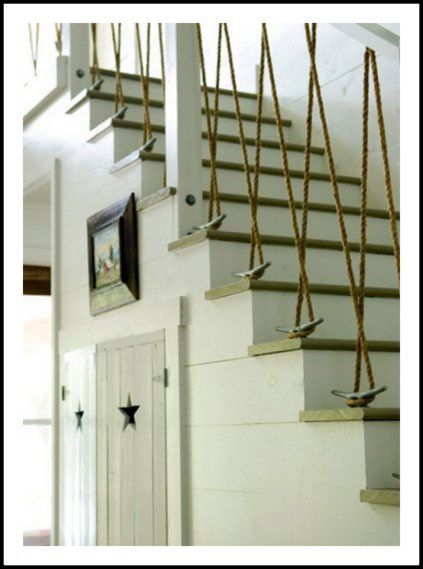 I love the star cutouts on the closet doors and the boat themed nautical rope bannisters going up the stairs.
