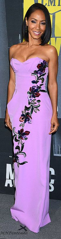 Jada Pinkett Smith walked the red carpet at the CMT Music Awards in a lilac-colored gown with floral embellishments