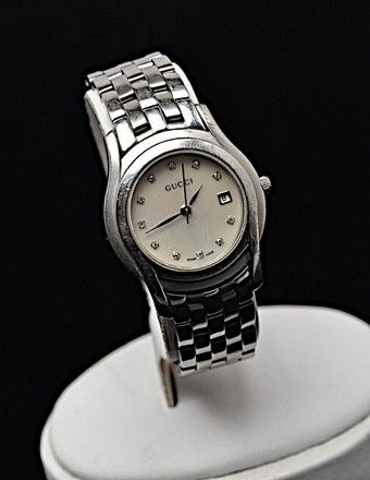 ab8545668ca Gucci Stainless Steel - Mop Face - Diamonds Swiss Made Water Resistant 5500  L Watch. Free shipping and guaranteed authenticity on Gucci Stainless Steel  ...