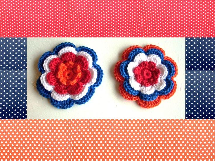 4-laags bloem rood wit blauw oranje.  7cm doorsnee.  1.50 per stuk.  Tot 15 april 20 % korting