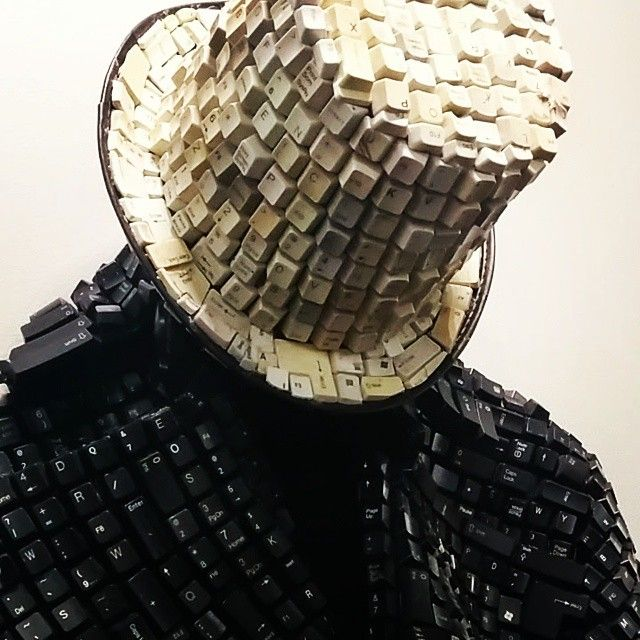 """""""I'm dragged into a virtual world of codes daily"""" Congolese-born Maurice Mbikayi: transforming old computer keyboards into way-out-outfits. He actually wore this sculptural outfit (and accompanying enormous shoes) for a performance at Cape Town Art Fair last night. An amazing 'suit of armour'."""