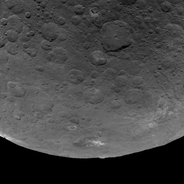This image of Ceres, taken by NASA's Dawn spacecraft, features several craters with bright material within and around them. The image is centered on terrain near the equator of Ceres and faces southeast. The large crater at top, just right of center, is named Nawish for the guardian of the field of the Acoma people. The 50-mile- (80-kilometer-) wide crater's southern rim is thrown into sharp relief by shadows.The view was acquired from an altitude of 2,700 miles (4,400 kilometers). The…