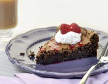 The rich, deep chocolatey flavor in every slice is balanced well with a garnish of fresh berries and vanilla cream.
