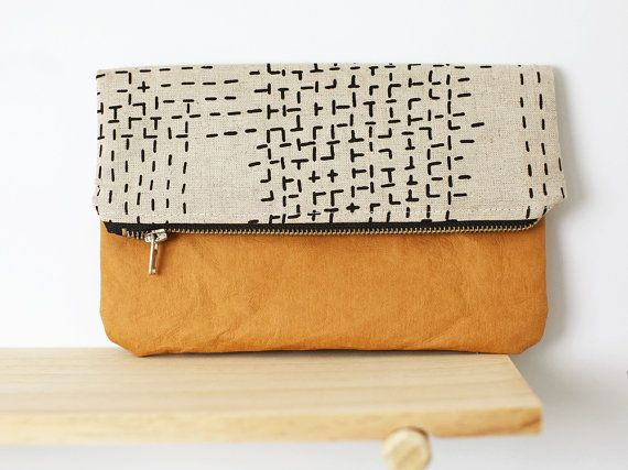Fold over clutch with washable paper