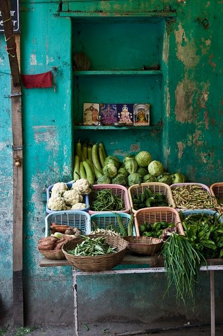 Market display of greens. Love the wall.