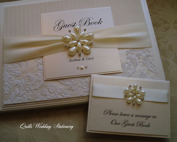 Luxury Personalised Wedding Guest Book. Fully decorated with damask flock and textured stripe paper, quality satin ribbon, decorated with a
