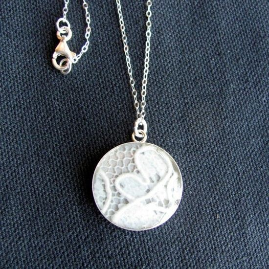 """Put a piece of your wedding gown into a necklace for your daughter to wear on their wedding day for her """"something old."""""""