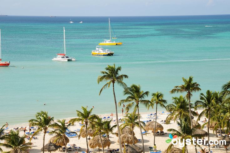 """Year-round sunny weather, white-sand beaches, friendly locals, and tasty international cuisine—these are a few of the reasons we love Aruba, and think you might, too. In addition to clear waters, which are perfect for snorkeling and diving, this Dutch Caribbean island offers plenty of opportunities to go windsurfing and parasailing, thanks to its consistently flowing warm winds. (It's no wonder it's dubbed itself as """"One Happy Island."""") But there's plenty more worth know..."""