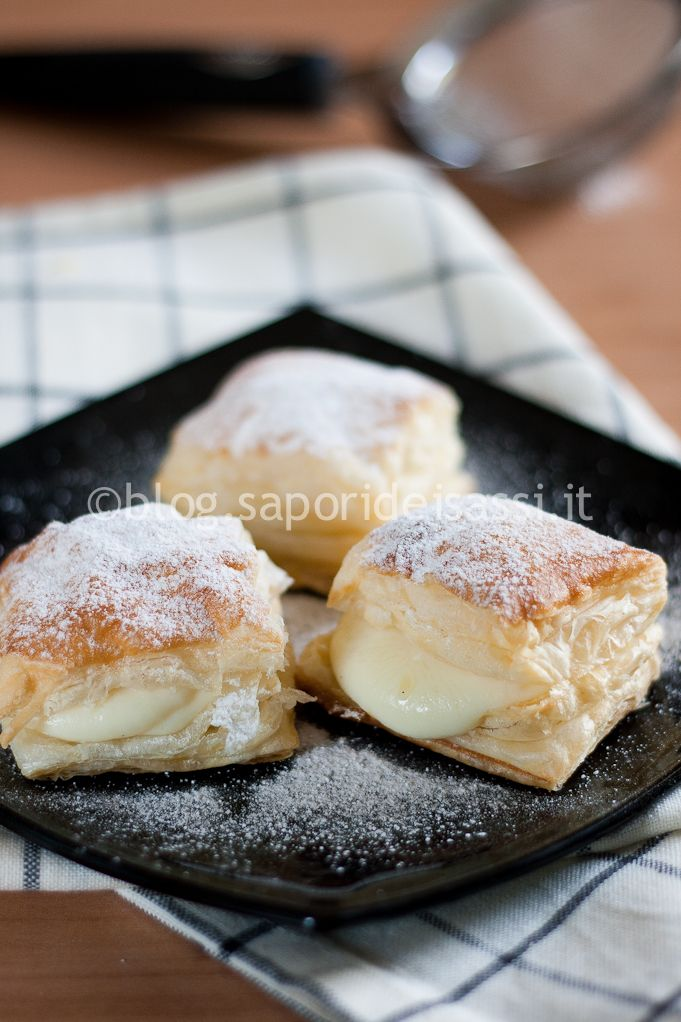 """""""Sporcamuss"""", traditional pastry from Apulia, Southern Italy: flaky pastry stuffed with custard cream"""