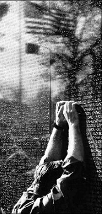 A soldier weeps at the Vietnam War Memorial via Will Henry's PTSD website
