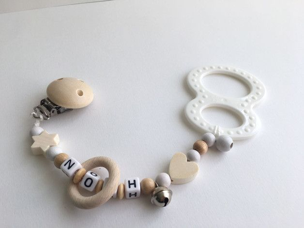 Beißkette,Zahnungshilfe für Babys  Da das Zahnen für Babys sehr quälend sein kann hilft diese Beißkette beim Durchstoßen der kleinen Zähnchen.  Befestigt ist ist ein Beißring  der sanft das...