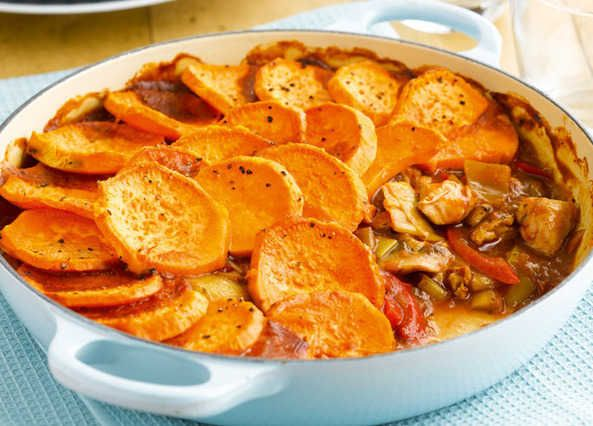 Sweet potato makes a tasty and wholesome topping for the chicken in this hotpot
