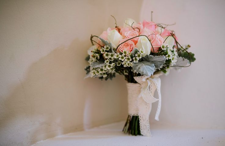Beautiful wedding bouquet by Freelance Flowers Coffs Harbour. Roses, Dusty Miller, Waxflower and Dog wood vine. Tied together with crotched lace. <3