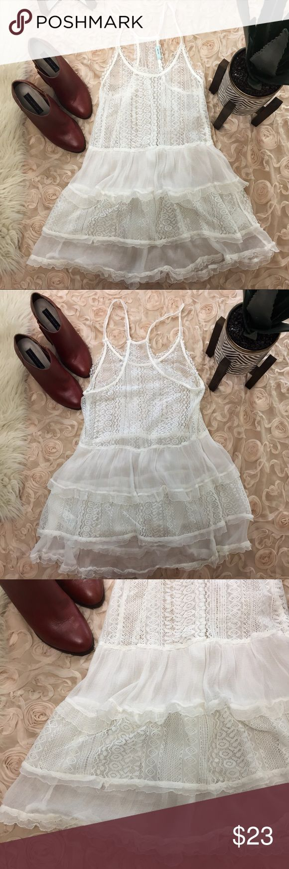 """U O •  kimchi blue  • lace racerback top Urban outfitters kimchi blue ivory/ white sheer lace racerback top. Approx 28"""" long 15"""" pit to pit. Excellent condition! Gorgeous top! Fits a little longer so it can be worn with leggings. Sheer is so on trend right now! Urban Outfitters Tops"""