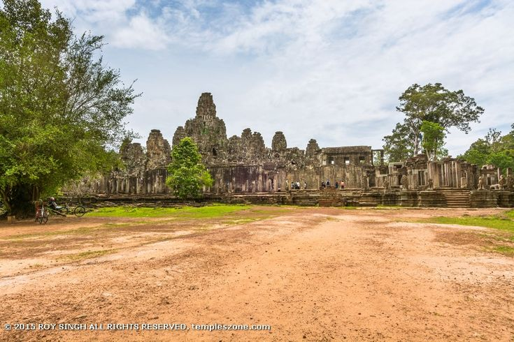 Angkor Thom city (two miles north of Angkor Wat) is moated walled classical style city that covers nearly four square miles and is laid out in a square and for centuries it was the seat of the Khmer government. The ruins are scattered over this large area. Most of the main temples were built under King Jayavarman VII.