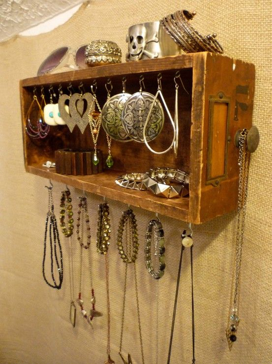 DIY - You could easily make this with  some cup hooks and vintage sewing machine drawers!