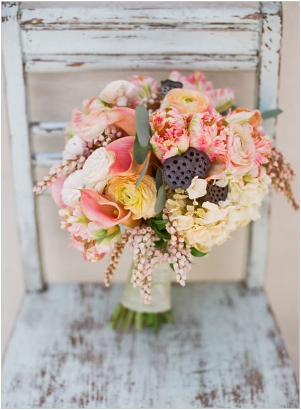 pretty pink and peach ranunculus, Dutch tulip, orchid and scabiosa pods bouquet