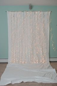 super easy diy backdrop for baby/newborn/toddler photography - hang up a nice sheet and string some lights.
