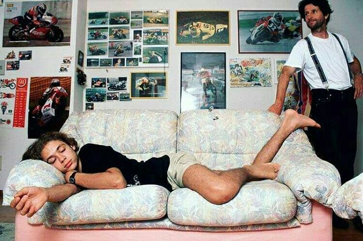Valentino Rossi VR46 asleep with father over looking him.