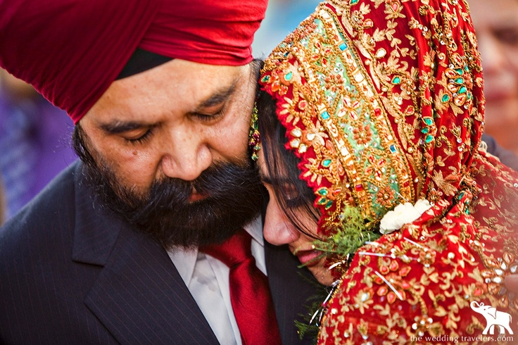 The vidaai - the bride, Kimmi, hugging her father goodbye. --- By The Wedding Travelers #indian #candid