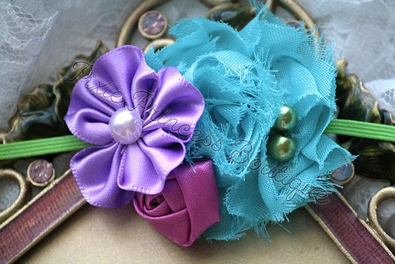 { {♥ Forget Me Not ♥} }  ♥ This adorably petite headband features a mini shabby flower in turquoise that is adorned with green pearls, a purple satin flower, and a rose