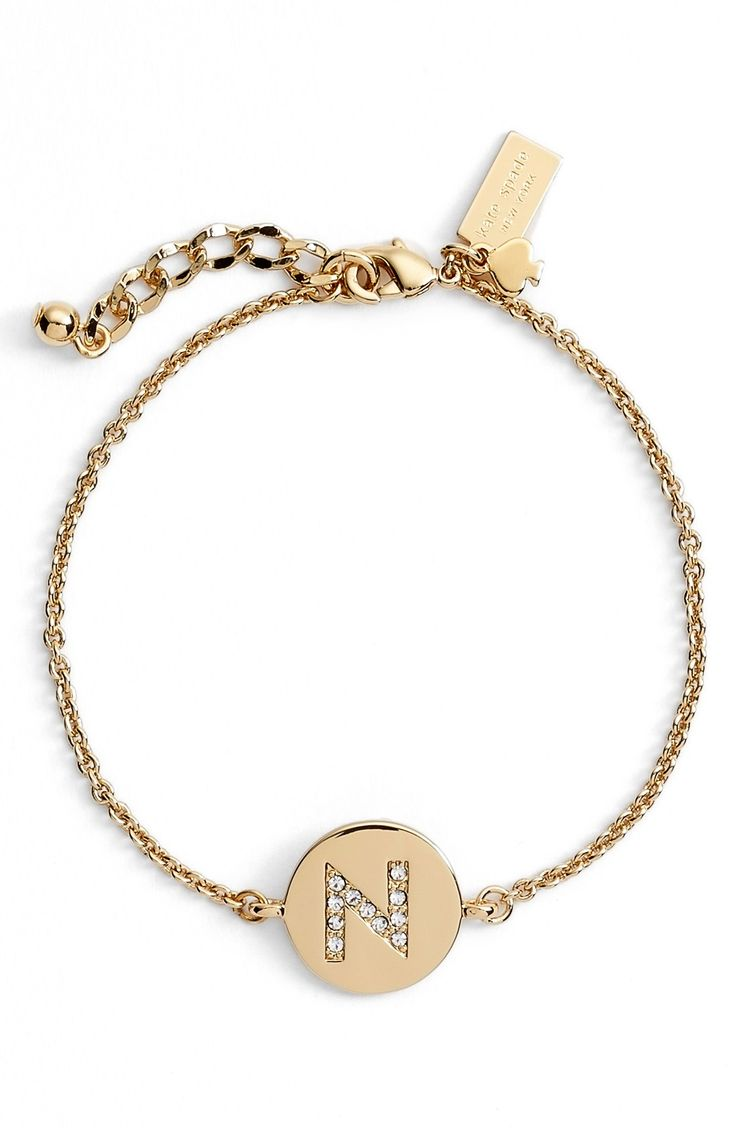 Sparkling crystals neatly arrange the initial of choice on this dainty, gold Kate Spade bracelet.