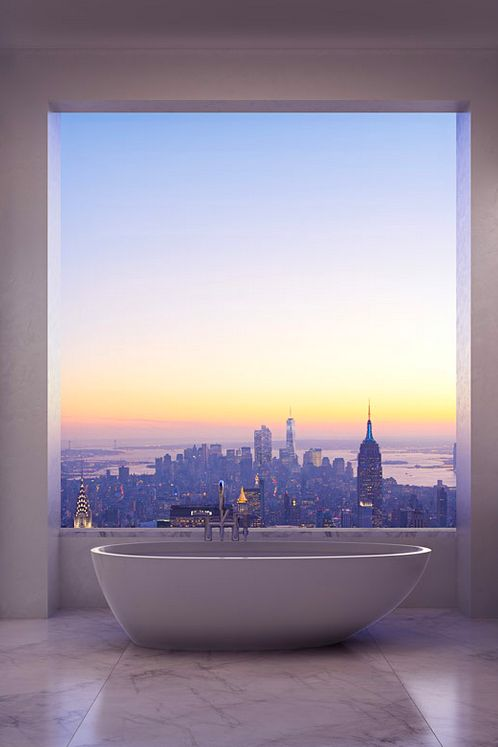 Overlooking The City. Large Window. Big Bath Tub. a bar to the left and speaker system to the right...leave me alone im relaxing